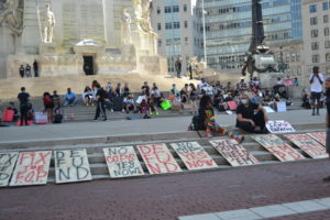 Protesters demonstrate around the Soldiers and Sailors Monument in downtown Indianapolis